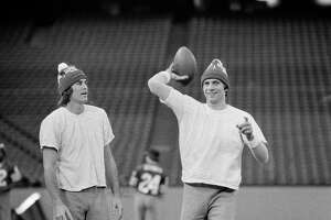 San Francisco 49ers Dwight Clark, left, and 49er quarterback Joe Montana wear their Super Bowl XVI hats as they go through a final workout in Pontiac's Silverdome, Michigan, on Saturday, Jan. 23, 1982, in preparation for Sunday's Super Bowl.