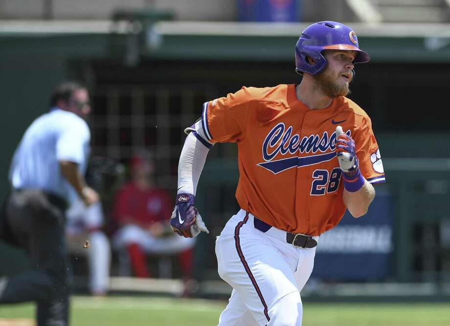 Clemson's Seth Beer rounds the bases Sunday after homering n a 9-8 victory over St. John's. The Tigers were unable to advance to a super regional, losing to Vanderbilt 19-6 later in the day. Photo: Bart Boatwright, MBR / Associated Press / The Greenville News