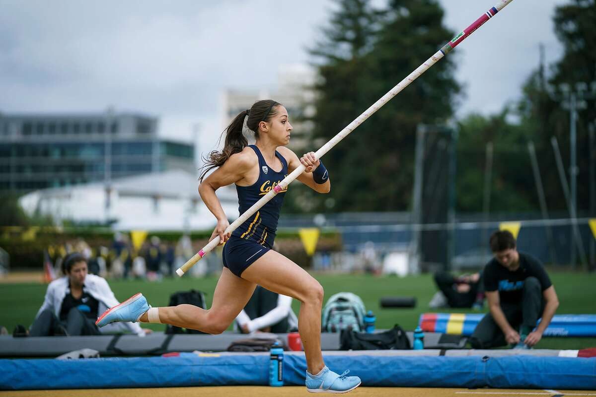 Cal pole vaulter sprints down the runway to initiate her takeoff.