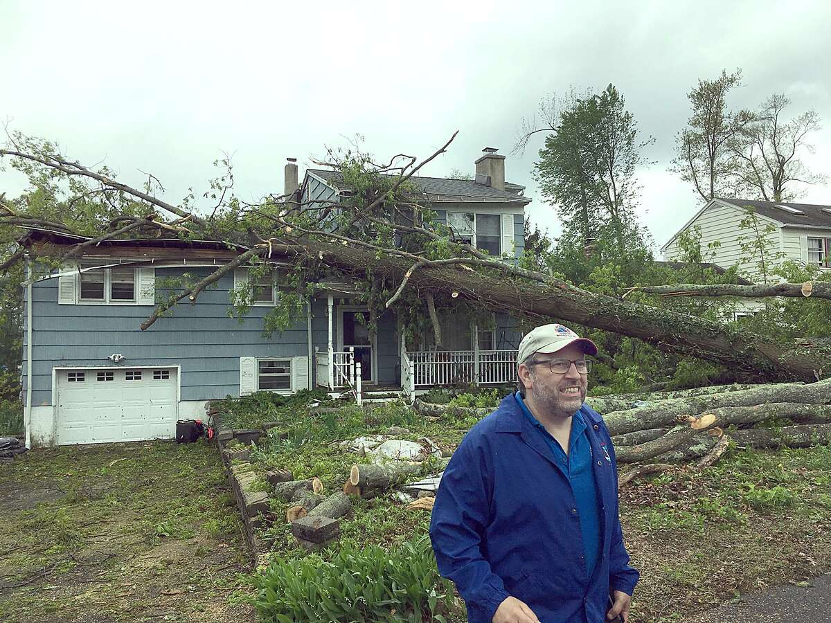 Bill Goodman, a meterologist with the National Weather service, surveys damage from a macroburst near Candlewood Shores in Brookfield Wednesday, may 16, 2018.