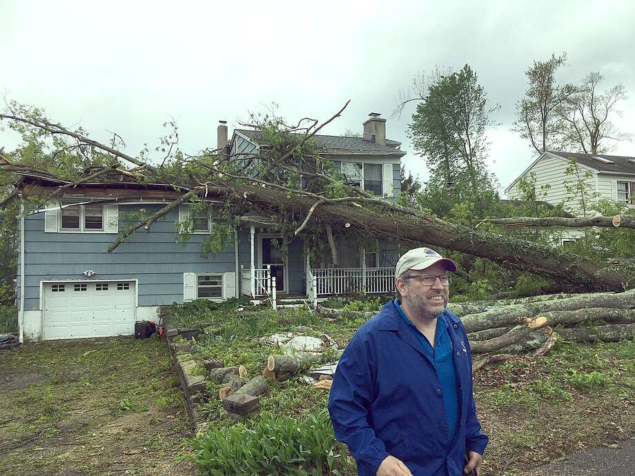 Bill Goodman, a meterologist with the National Weather service, surveys damage from a macroburst near Candlewood Shores in Brookfield Wednesday, may 16, 2018. Photo: Dirk Perrefort / Hearst Connecticut Media / The News-Times