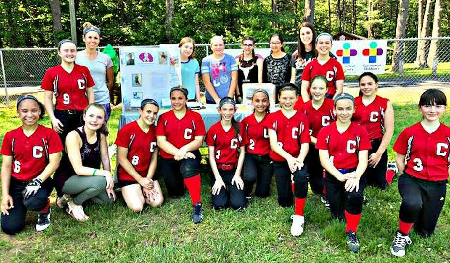 Cromwell Middle School softball players recently held a Strike out Cancer benefit during its game against Strong Middle School in Durham. Photo: Contributed Photo