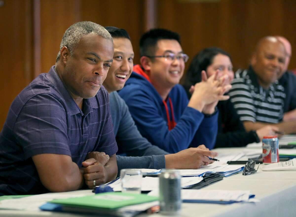 Community engagement officer Raphael Rockwell (left) listens to a speaker during a class in providing tactics for deescalating interactions and avoiding the use of force with youth at the San Francisco Scottish Rite Masonic Center on Thursday, May 31, 2018 in San Francisco, Calif. San Francisco Police Department officers attend a four day Policing the Teen Brain train-the-trainer session.