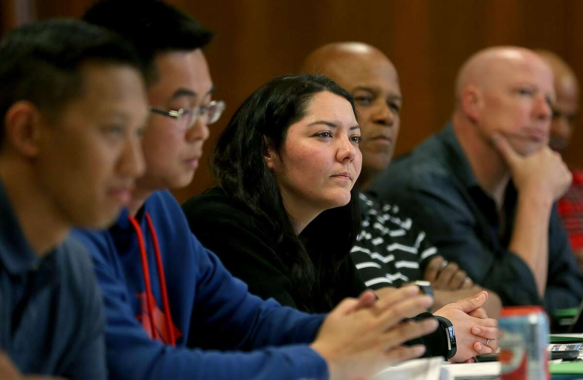 Field operation bureau officer Lili Gamero (middle) listens to a speaker during a class in providing tactics for deescalating interactions and avoiding the use of force with youth at the San Francisco Scottish Rite Masonic Center on Thursday, May 31, 2018 in San Francisco, Calif. San Francisco Police Department officers attend a four day Policing the Teen Brain train-the-trainer session.