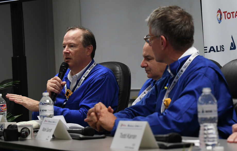 From left, Bryan Canfield Total general manager of the Port Arthur facility, Bernard Pinatel Total president and Mark Garrett CEO Borealis address questions from the media Monday after the groundbreaking ceremony for Total's ethane cracker. Photo taken Monday, June 04, 2018 Guiseppe Barranco/The Enterprise Photo: Guiseppe Barranco / Guiseppe Barranco ?