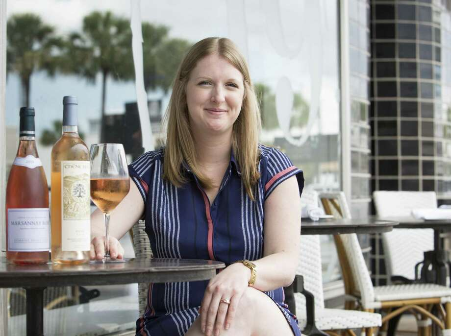 Wendy Kfoury, general manager at Brasserie 19, with her wine choices on the restaurant's patio. Photo: Yi-Chin Lee / Houston Chronicle / © 2018 Houston Chronicle