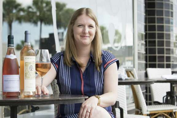 Wendy Kfoury, general manager at Brasserie 19, with her wine choices on the restaurant's patio.