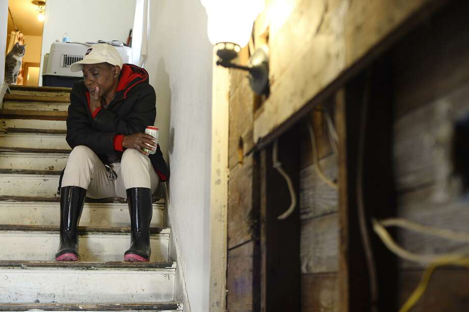 Mary Rodgers sits on the staircase in her damaged home in Port Acres in January after heavy rains brought another flood amid the struggle to repair Harvey damage. Photo: Ryan Pelham / Ryan Pelham / Ryan Pelham/The Enterprise / ©2017 The Beaumont Enterprise/Ryan Pelham