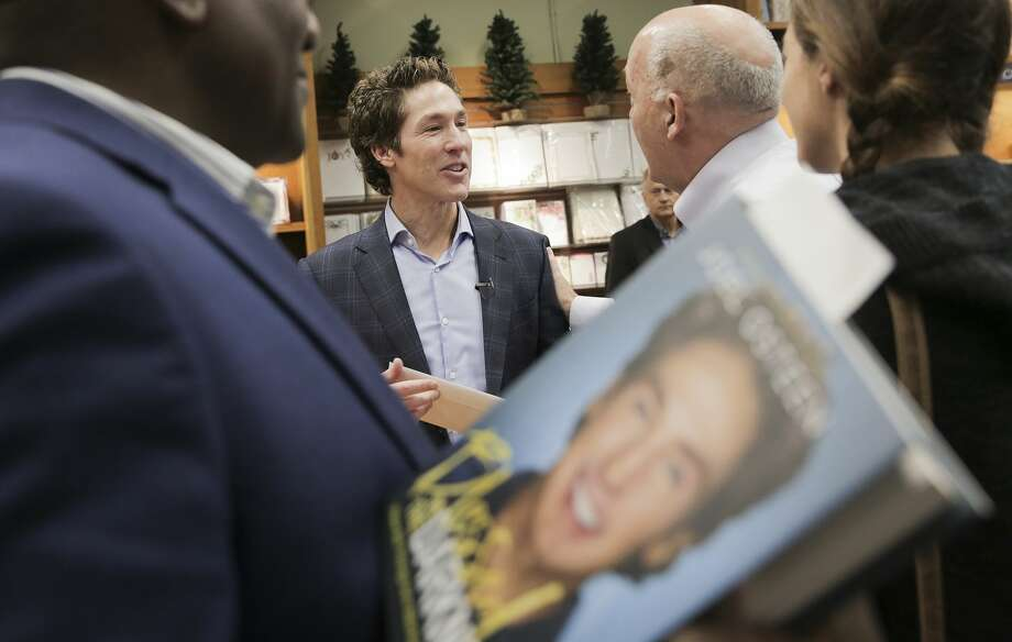 Houston minister Joel Osteen signs books  at Vromon's Bookstore on Friday, Oct. 27, 2017, in Pasedena. Photo: Elizabeth Conley/Houston Chronicle