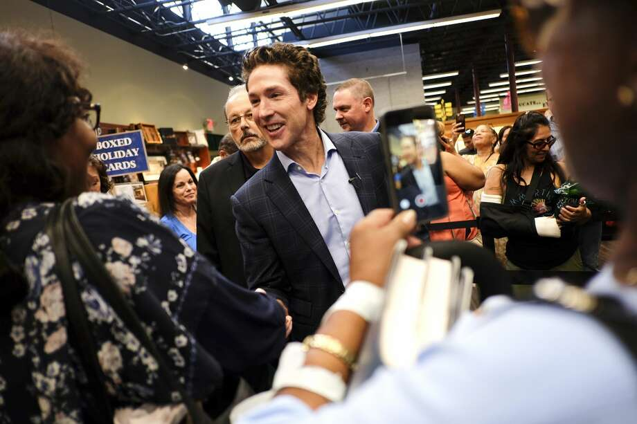 Fans and followers greet Joel Osteen at Vroman's Bookstore in Pasedena, Calif. Photo: Elizabeth Conley/Houston Chronicle