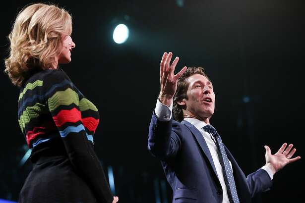 """Minister Joel Osteen talks to attendees at """"A Night of Hope"""" with his wife, Vicoria on Saturday, Oct. 28, 2017, in Los Angeles. ( Elizabeth Conley / Houston Chronicle )"""