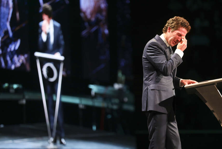 Joel Osteen pulled a tissue from his pocket when he began to cry while talking about his brother during A Night of Hope event. Photo: Elizabeth Conley