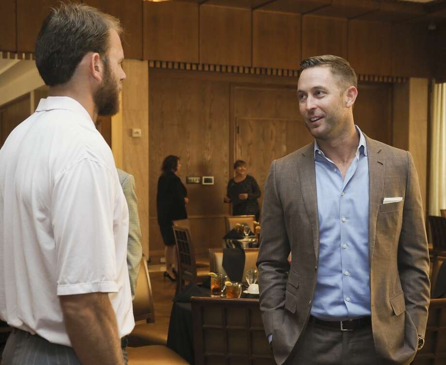 Texas Tech head football coach Kliff Kingsbury talks with former Tech qb Taylor Potts 06/05/18 before a luncheon with Red Raider Club members at the Petroleum Club. Tim Fischer/Reporter-Telegram Photo: Tim Fischer/Midland Reporter-Telegram