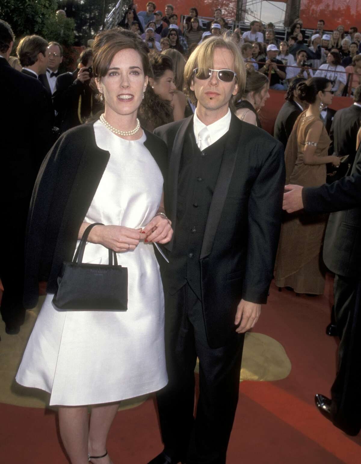 Iconic designer, Kate Spade was found dead in an apparent suicide on June 5. >> See the legendary fashionista through the years. 1997: David Spade and Kate Spade during The 69th Annual Academy Awards - Arrivals at Shrine Auditorium in Los Angeles, California, United States.