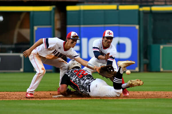 Huffman centerfielder Stephen Keller slides in safely at second base despite the defensive effort of the tandem of Hardin-Jefferson shortstop Logan McLeod, left, and second baseman Bucky Lemons in the top of the 5th inning of their district matchup as part of the Houston Astros High School School Baseball Experience at Minute Maid Park on April 24, 2017. (Photo by Jerry Baker/Freelance)