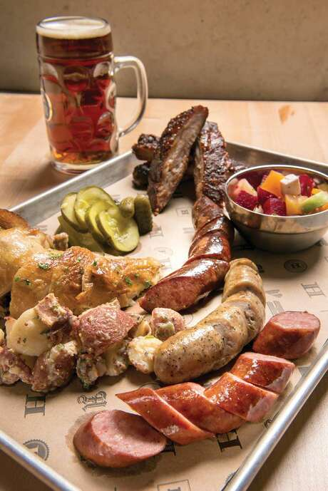 The Family Style Half Haus: Sausages, pork ribs, beer-can chicken, potato salad, sauerkraut and pickles Photo: Mara Lavitt
