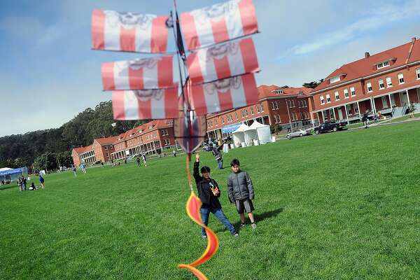 Brothers Nathan Ngo, left, and Ben Ngo try to launch their pirate ship kite at the Family Day Kite Festival in San Francisco, California, Saturday August 17, 2013.