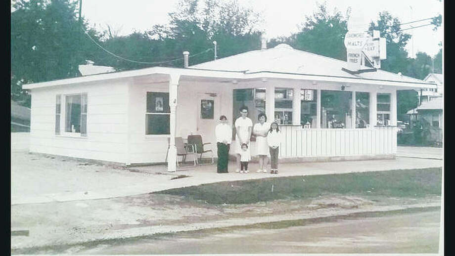 In a vintage photograph, left to right, Alzheimer's Association volunteer Stacey Howard, far right, stands in front of her father's ice cream shop, Tasti Corner, in Highland, Illinois, with her older sister, Stephanie, far left, next to their mother, Shirley, and their aunt, Jane, second from right. Howard's younger sister, Shannon, stands in front with their mother behind. Photo:       For The Telegraph