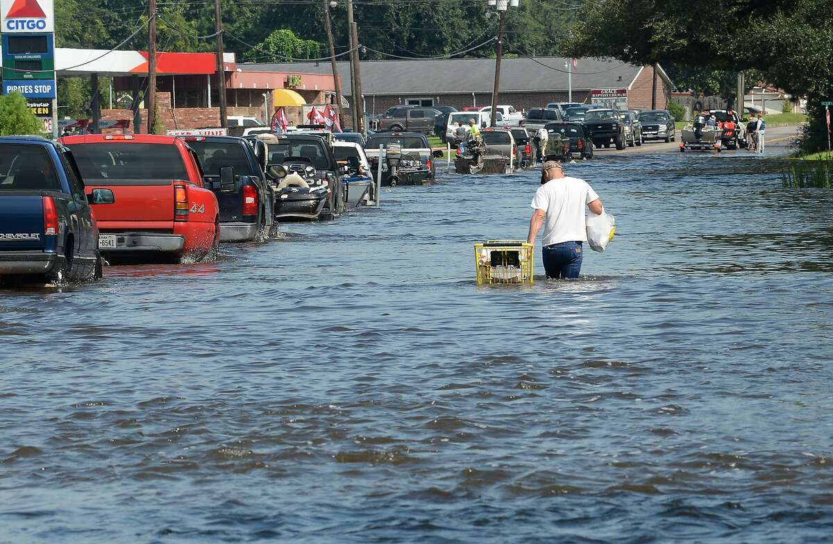 Elray Johnson pushes a cart of food and drinks Thursday to his friends living in north Vidor. While several parts of the city are flooded, the northern side received extensive damage. Photo taken Thursday, August 31, 2017 Guiseppe Barranco/The Enterprise