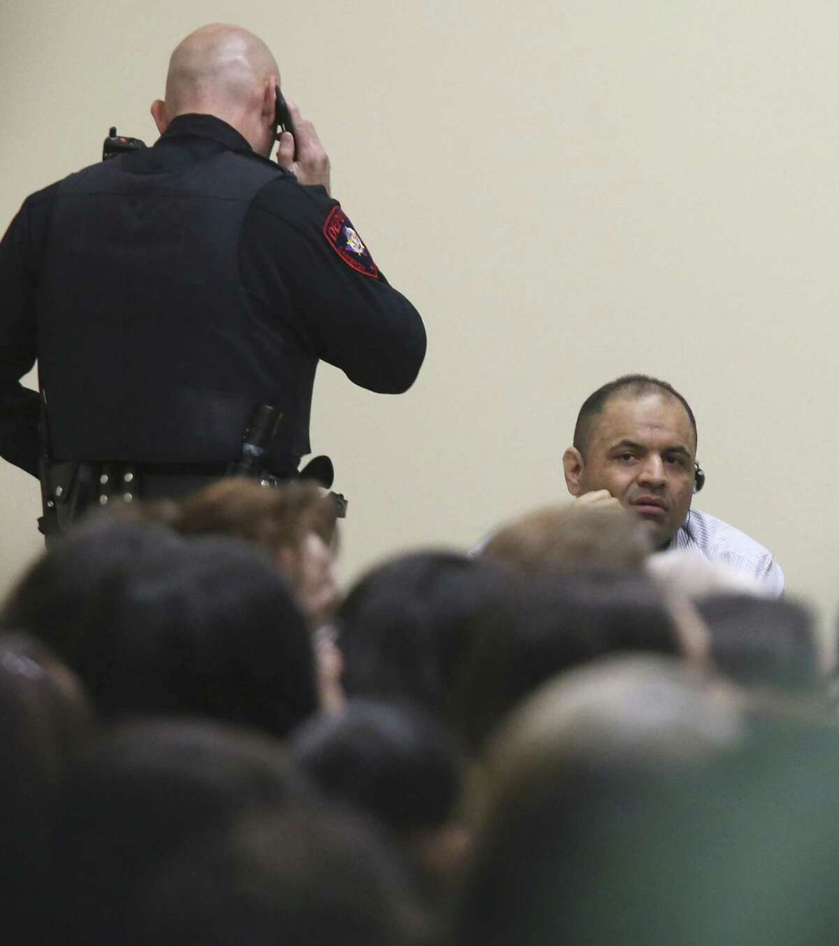 Mexican national Gustavo Tijerina-Sandoval, lower left, sits in front of the jury pool as jury selection begins in his capital murder trial in the Cameron County 197th District Court in Brownsville, Texas, Tuesday, Feb. 13, 2018. Tijerina-Sandoval is accused of killing U.S. Border Patrol agent Javier Vega in August of 2014. Vega was fishing with his family in Santa Monica, a secluded area near Harlingen, when two men attempted to rob the group. Vega pulled out his weapon and was shot in the chest. He died en route to the hospital. Tijerina-Sandoval and Ismael Hernandez-Vallejo are both charged in Vega's death, but their trials will be held separately. One of his attorneys Nat Perez, Jr. is on the right.