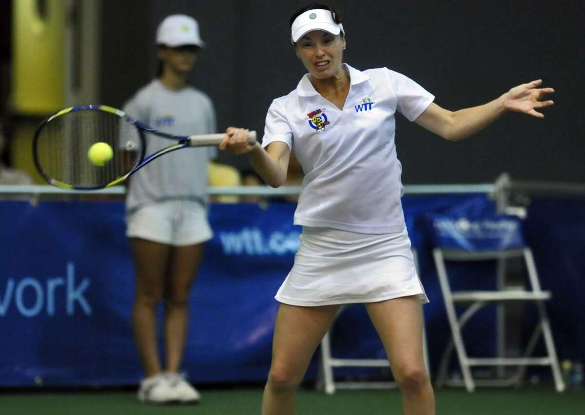 Martina Hingis returns a serve during a mixed doubles match with the New York Buzz during their World TeamTennis season opener against the Philadelphia Freedoms on Monday night at SEFCU Arena at the University at Albany. The Buzz lost 21-10. (Philip Kamrass / Times Union )
