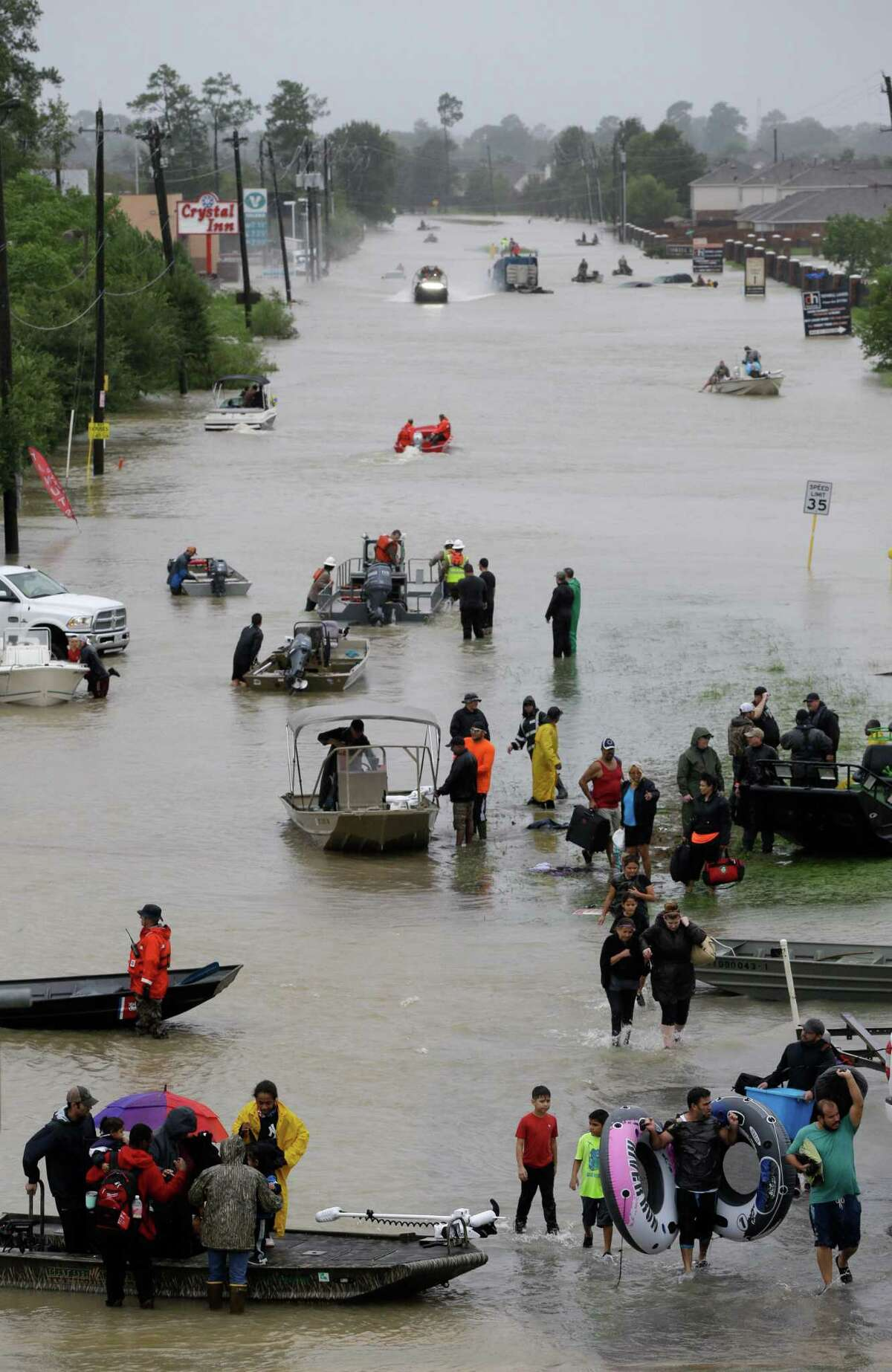 Rescue boats work along Tidwell at the east Sam Houston Tollway helping to evacuate people Monday, August 28, 2017 after Hurricane Harvey inundated the area. >>See the devastation left by Hurricane Harvey through Google Maps in the photos that follow.