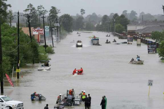 Rescue boats work along Tidwell at the east Sam Houston Tollway helping to evacuate people Monday, August 28, 2017 after Hurricane Harvey inundated the area.