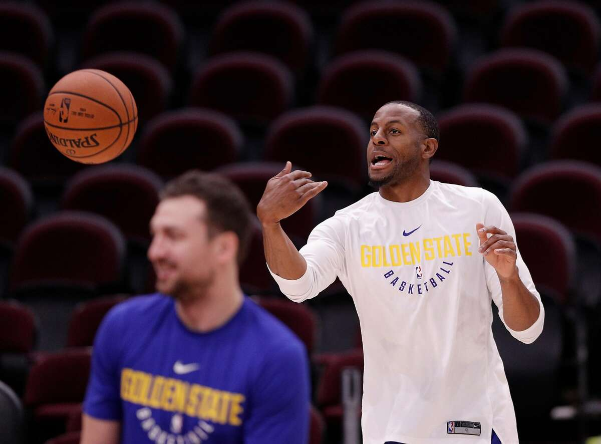 Andre Iguodala (9) passes a ball underhand during an off day practice and media day at Quicken Loans Arena before the Golden State Warriors play the Cleveland Cavaliers in Game 3 of the NBA Finals in Cleveland, Ohio, on Tuesday, June 5, 2018.