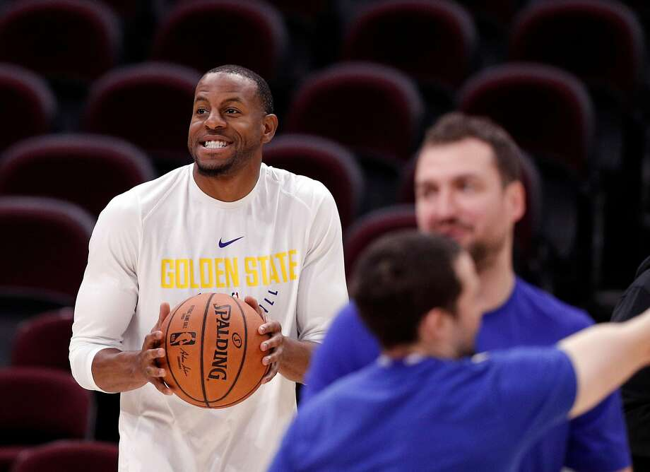 31205228d494 Andre Iguodala (9) grins as he begins to shoot during an off day practice