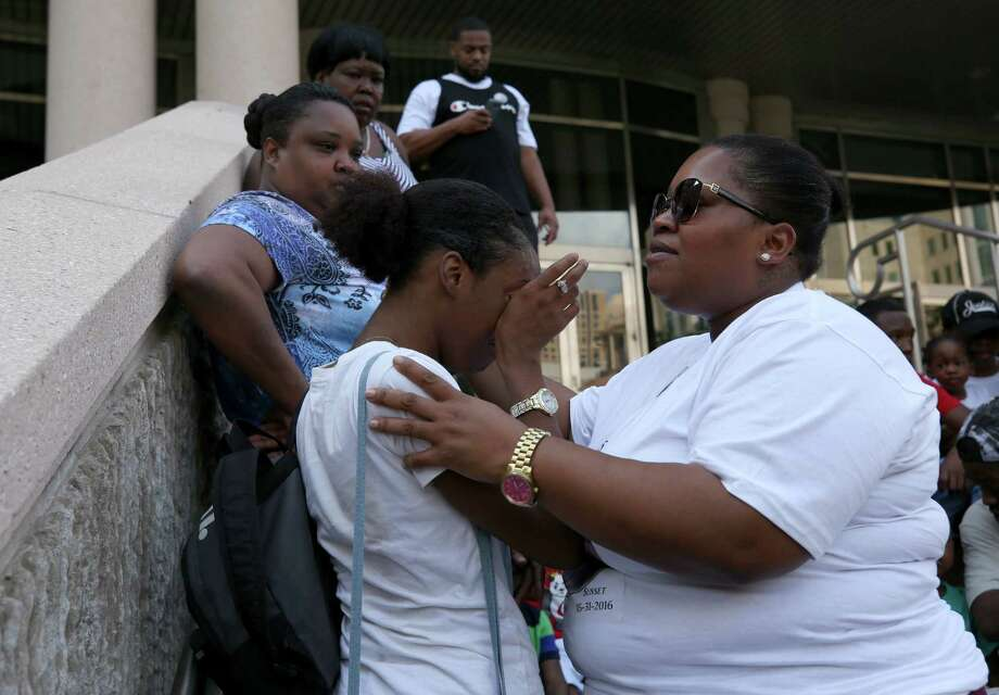 Lakita Carr, right, comforts Angelina Leffyear after a press conference on the steps of the Harris County Civil Courthouse Tuesday, June 5, 2018, in Houston. Carr's 21-year-old son Darrall Thomas died in police custody May 31, 2016. Leffyear and Thomas were engaged for a year when he died. The family has filed a suit against Spring Valley Village, Hedwig Village, Bunker Hill Village, Piney Point Village, Hunters Creek Village, Spring Branch ISD and several of their police officers. Photo: Godofredo A. Vasquez, Houston Chronicle / Godofredo A. Vasquez