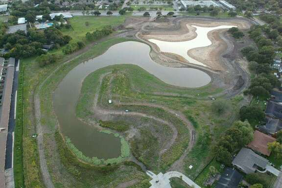The Tomball city council approved an ordinance on Monday to maintain detention ponds similar to this one. Ponds that are not maintained tend to have accumulated silt and overgrown vegetation that prevent it from working as designed.