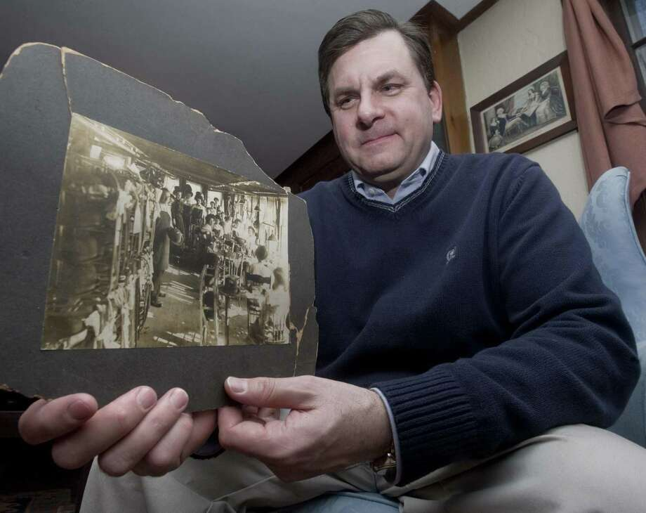 Patrick Wild, town historian in Bethel, holding a 1915 photograph with his grandmother, Catherine Tierney Wild, working at the Frank H. Lee hat factory in Danbury. Tuesday, Jan. 25, 2011 Photo: Scott Mullin / ST / The News-Times Freelance