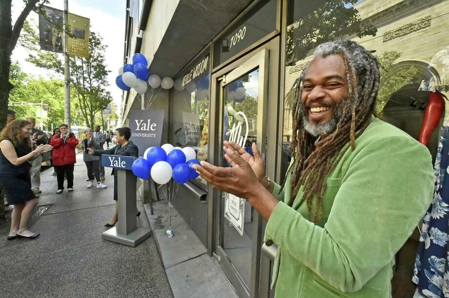 Fashion designer Neville Wisdom applauds remarks by New Haven Mayor Toni Harp during a ribbon cutting ceremony Tuesday afternoon for his new storefront on Chapel Street, Neville Wisdom Fashions, at The Shops at Yale between The Juice Box and Atticus Bookstore & Cafe and across from the Yale Art Gallery. Photo: Peter Hvizdak / Hearst Connecticut Media / New Haven Register