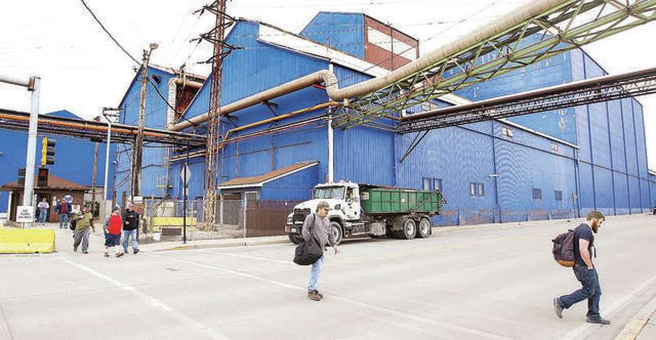 In this 2015 file photo, workers leave the United States Steel-Granite City Works. Workers will soon be heading the other direction, into the plant, after the company announced Tuesday that they will restart the second blast furnace, creating 300 jobs at the facility. Photo:     John Badman | The Telegraph