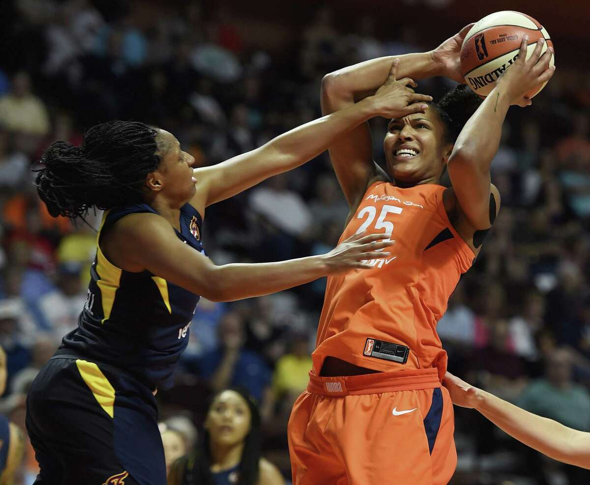 Connecticut Sun forward Alyssa Thomas is fouled by Indiana Fever guard Kelsey Mitchell, left, during the first half of a WNBA game on May 26.
