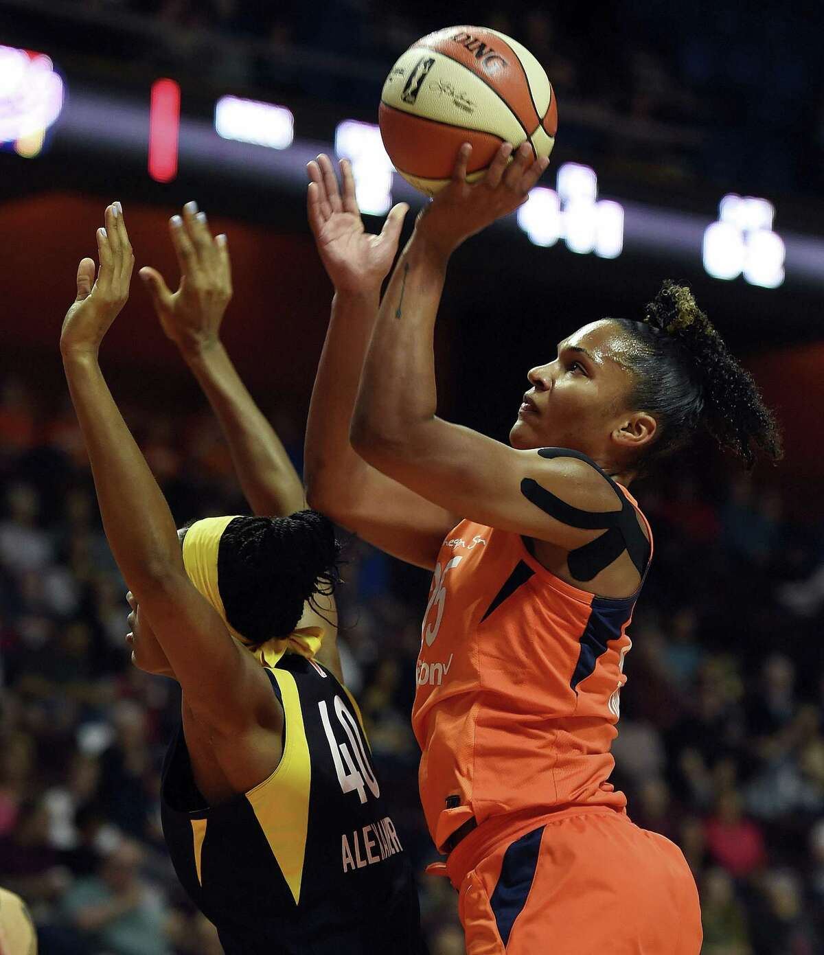 Connecticut Sun forward Alyssa Thomas shoots over Indiana Fever center Kayla Alexander during the first half of a WNBA game on May 26.
