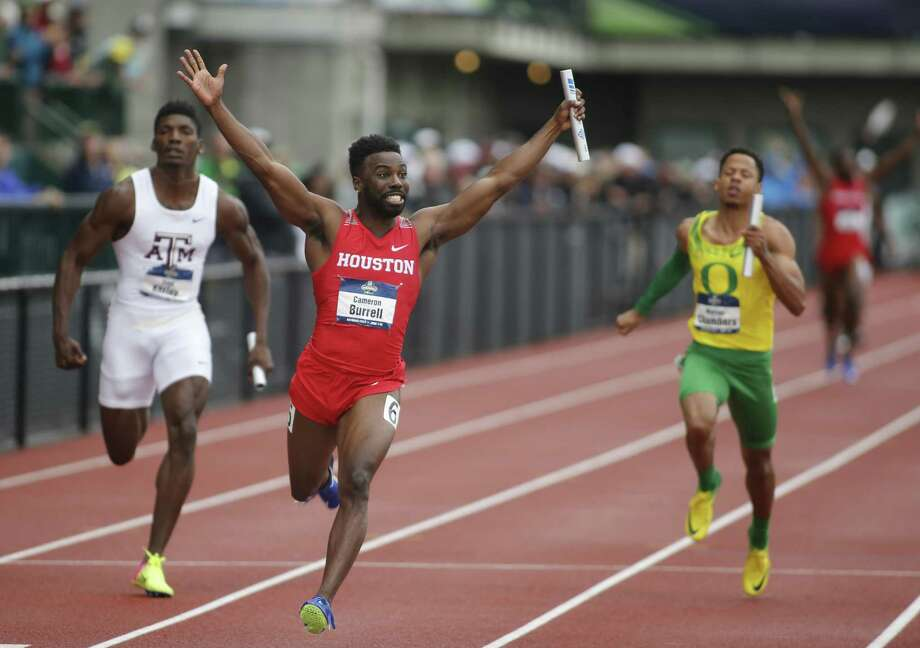 Houston's Cameron Burrell raises his arms in victory in after crossing  the finish line in the men's 400-meter relay on the third day of the  NCAA outdoor college track and field championships in Eugene, Ore.,  Friday, June 9, 2017. Houston's wining time was 38.34 seconds (AP  Photo/Timothy J. Gonzalez) Photo: Associated Press, FRE / Associated Press / FR11177 AP