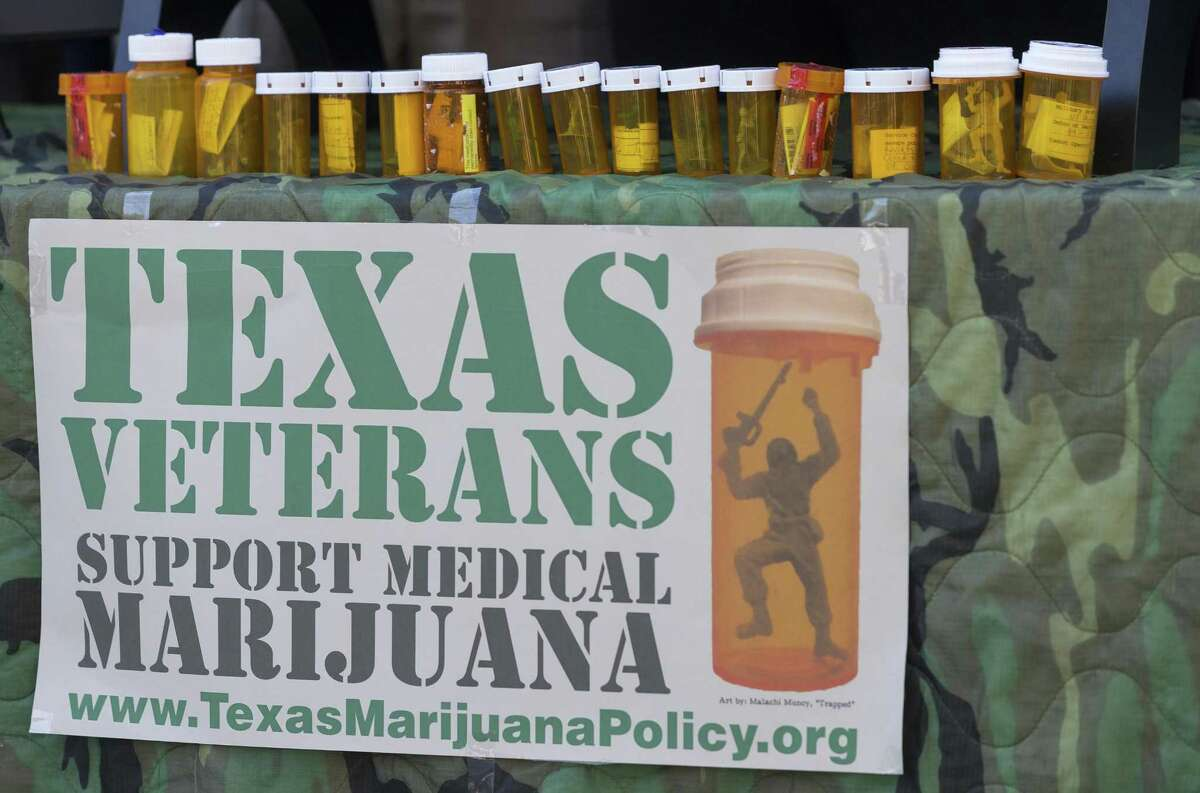 Medicine bottles filled with army men toys sit on display at the veterans memorial outside the Texas Capitol in Austin, Wednesday, Feb. 22, 2017. The group of military veterans gathered for a press conference and deliver letters requesting the governor meet with veterans to discuss the use of medical marijuana to treat service-related conditions.