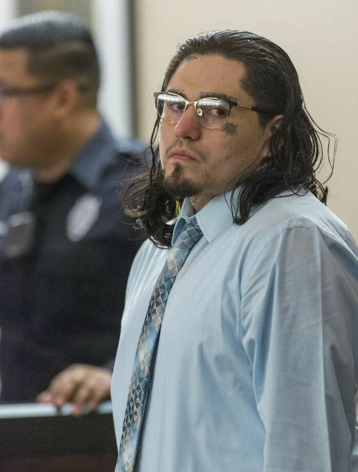Daniel Moreno Lopez looks Tuesday, June 05, 2018, around Judge Ron Rangel's 379th state District Court as the jury, not pictured, enters the courtroom during closing arguments in Moreno's murder trial. Lopez is on trial for the killing, dismembering and attempted grilling of the limbs of Jose Luis Menchaca, who was beaten with baseball bats and suffocated with a plastic bag. Photo: William Luther/San Antonio Express-News