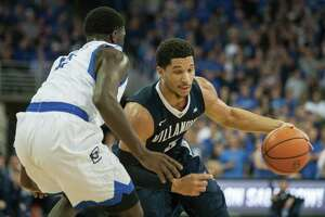 FILE - In this Saturday, Dec. 31, 2016 file photo, Villanova guard Josh Hart (3) dribbles the ball into lane with Creighton guard Khyri Thomas (2) guarding him during the first half of an NCAA college basketball game in Omaha, Neb. Hart is a candidate for Big East player of the year and national player of the year for the reigning NCAA champions, Wednesday, March 1, 2017. (AP Photo/John Peterson, File)