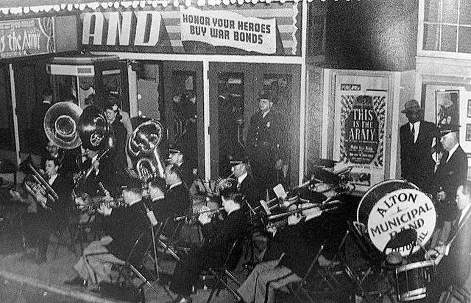 The Alton Municipal Band has been around since 1891. Here, they are shown playing for a war bond drive during World War II in front of the Grand Theatre in Alton. Photo:       File Photo