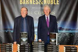 """NEW YORK, NY - JUNE 05: James Patterson (L) and Bill Clinton sign copies of their new book """"The President Is Missing"""" at Barnes & Noble, 5th Avenue on June 5, 2018 in New York City. (Photo by Slaven Vlasic/Getty Images)"""