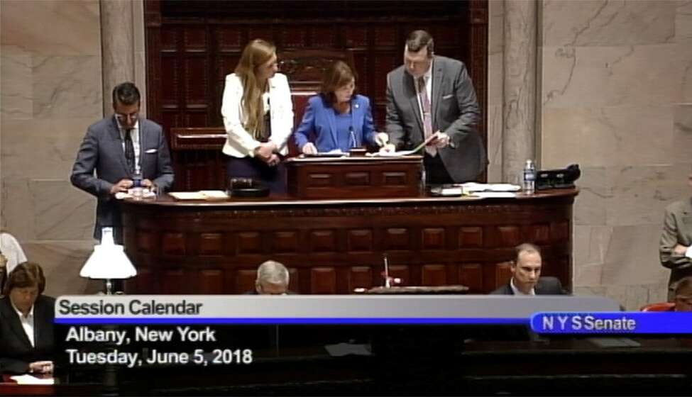 Lt. Gov. Kathy Hochul oversees a chaotic day in the state Senate, which included a veto override vote and a procedural floor fight on Tuesday, June 5, 2018. (Screenshot)