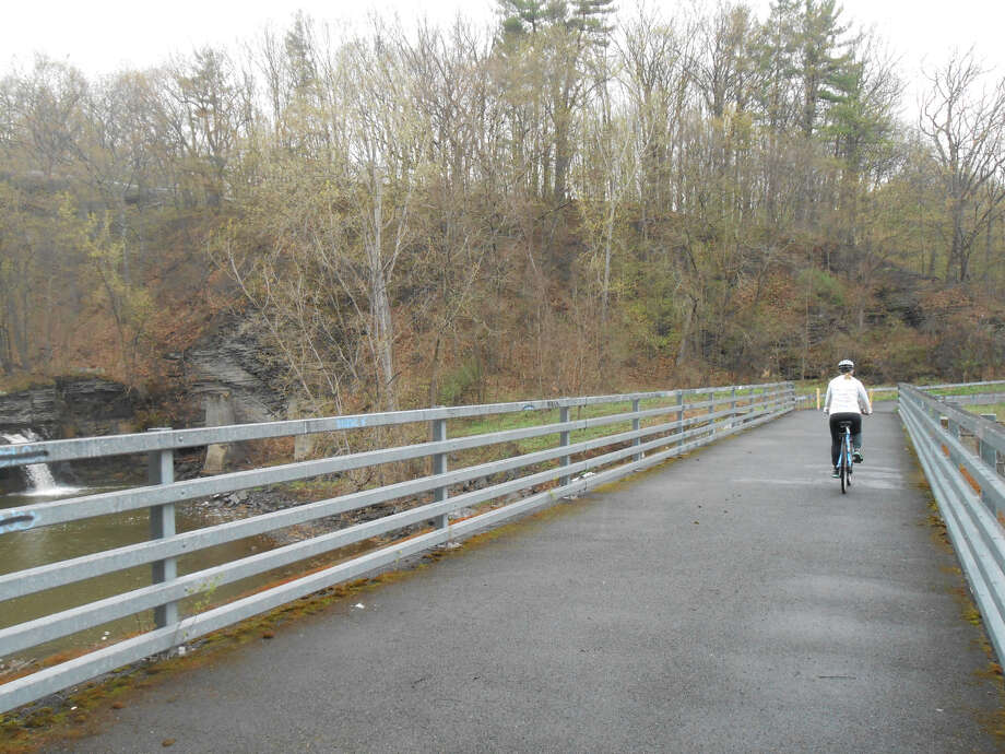 The pedestrian/ bike bridge over the Normanskill where it meets the Watervliet Reservoir is a popular spot along the rail trail. (Contributed photo) Photo: Contributed Photo