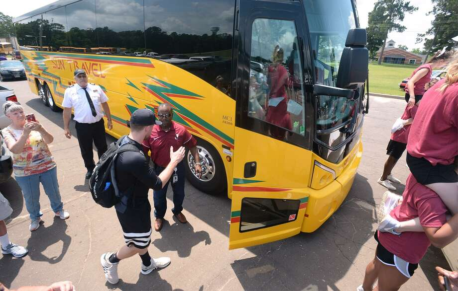 Jasper baseball players board a bus Tuesday to compete in the State tournament in Austin. The Bulldog's first game is Wednesday at 1 p.m.  Photo taken Tuesday, June 05, 2018  Guiseppe Barranco/The Enterprise Photo: Guiseppe Barranco,  Photo Editor / Guiseppe Barranco ©