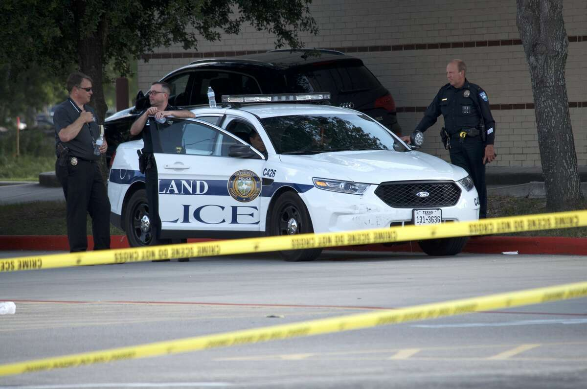 Pearland police investigate an officer-involved shooting at a Walmart store in the 1900 block of N. Main Street on Tuesday, June 5, 2018.