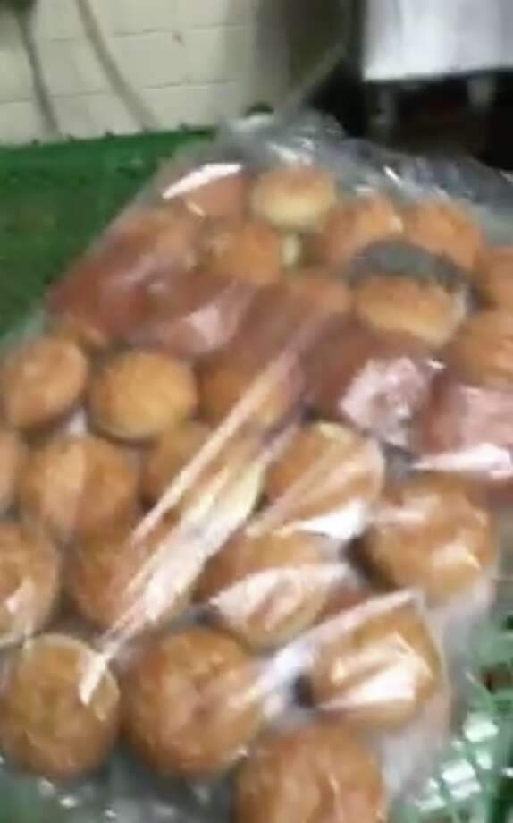 Screenshots from a Facebook video show rodents scurrying inside a bag of hamburger buns at a Burger King restaurant in Wilmington, Delaware. Photo: Shantel Johnson