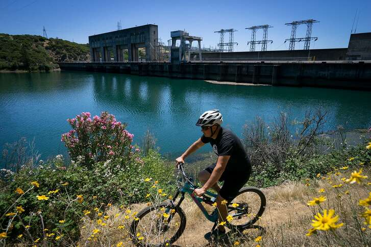 Brent Weaver rides on the Fisherman's Trail in Redding, Calif. on Friday, June 1, 2018.