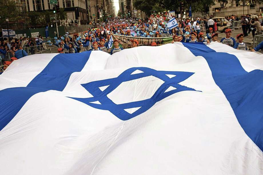People carry an Israeli flag as they march during the annual Celebrate Israel parade, Sunday, June 3, 2018, in New York. Photo: Andres Kudacki, FRE / Associated Press / FR170905 AP