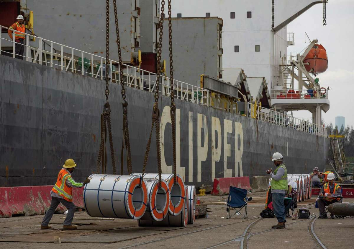 Workers unload a steel shipment at the Port of Houston Turning Basin General Cargo Terminal on March 2, 2018, in Houston.